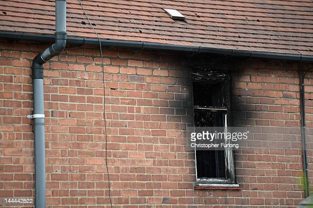 The fire scorched window of a house in Allerton following the fire which claimed the lives of six children on May 14 2012 in Derby England Duwayne...