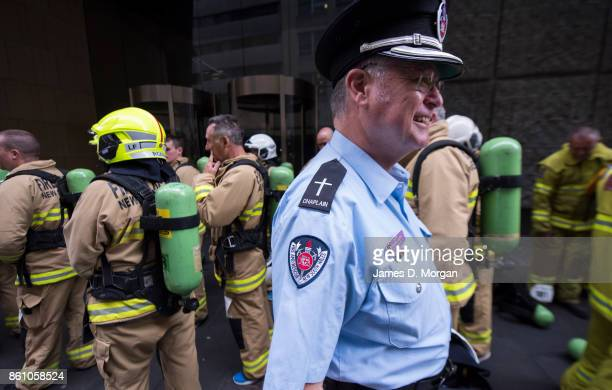 The fire service chaplain greeting firefighters as they wait to climb 1504 steps of Sydney Tower in their full uniform on October 14 2017 in Sydney...