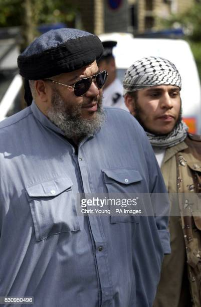 The firebrand cleric Sheik Abu Hamza Mullah at the Finsbury Park Mosque arrives with an unidentified man ahead of a demonstration which was held...