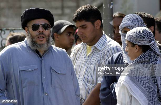 The firebrand cleric Sheik Abu Hamza Mullah talks to unidentified youths at the Finsbury Park Mosque arrives ahead of a demonstration which was held...