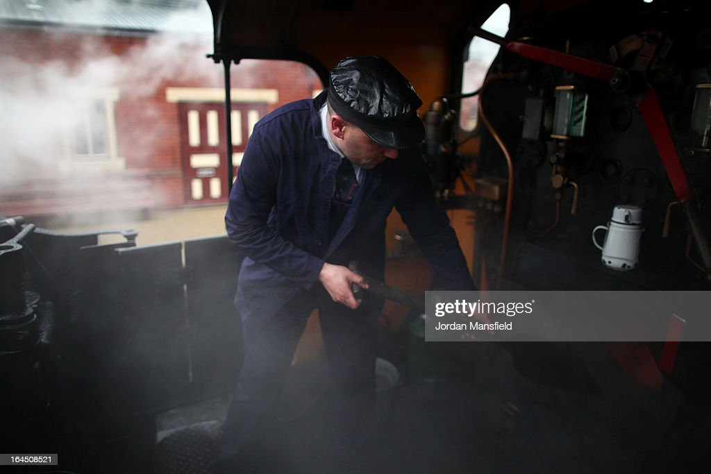 The fireman Darren French shovels coal on the Grinsteade Belle on March 23, 2013 in Uckfield, England. The Bluebell Railway ran its first steam train this weekend on the reclaimed line from Kingscote to East Grinstead after volunteers from the Bluebell Society worked to reopen the line after its closure on March 17, 1958. 50 years on from Dr. Richard Beeching's report signaling the widespread closure of rural rail routes across the UK, Britain's railways are in great demand with old lines reopening and pressure on to restore rural lines that were closed.