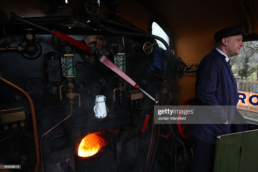 The fireman Darren French stands by the engine of the Grinsteade Belle on March 23, 2013 in Uckfield, England. The Bluebell Railway ran its first steam train this weekend on the reclaimed line from Kingscote to East Grinstead after volunteers from the Bluebell Society worked to reopen the line after its closure on March 17, 1958. 50 years on from Dr. Richard Beeching's report signaling the widespread closure of rural rail routes across the UK, Britain's railways are in great demand with old lines reopening and pressure on to restore rural lines that were closed.