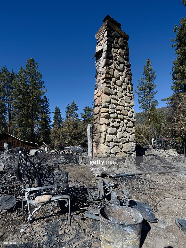 The fireplace chimney stands still at the burned out cabin where the remains of multiple murder suspect and former Los Angeles Police Department officer Christopher Dorner were found is seen on February 15, 2013 in Big Bear, California. Dorner, a former Los Angeles Police Department officer and Navy Reserve veteran, barricaded himself in the cabin near Big Bear, California, and engaged law enforcement officers in shootout, shooting two police, killing one and wounding the other. Dorner's, who's body was identified after being found, was wanted in connection with the deaths of an Irvine couple and a Riverside police officer.
