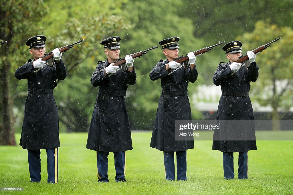 The firing party fires shots during the funeral of Army Corporal David J. Wishon at Arlington National Cemetery May 6, 2016 in Arlington, Virginia. Corporal Wishon was assigned to a medical unit in the 7th Infantry Division when he went missing after an attack on Dec. 1, 1950 in the Korean War.