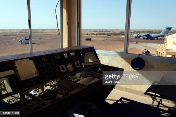 The first A 400M Atlas French military transport aircraft and a United Nations helicopter are seen from the control tower at the Gao airport on...