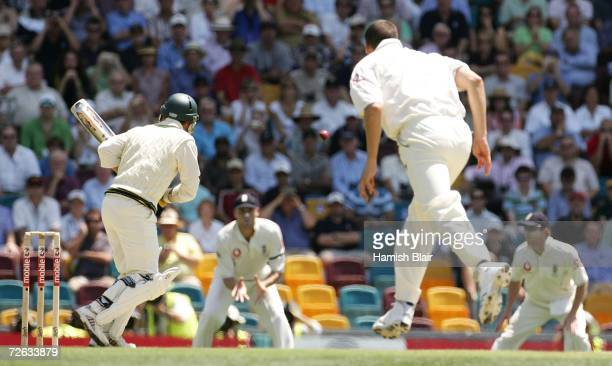 The first ball of the series bowled by Steven Harmison of England to Justin Langer of Australia heads towards Andrew Flintoff of England at second...