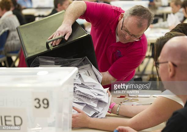 The first ballot boxes are emptied at the counting centre for Paisley and Renfrewshire at the Lagoon Leisure Centre paisley Scotland on May 7 2015...