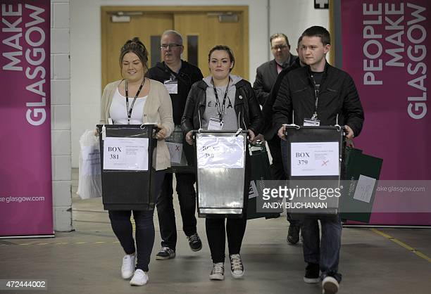 The first ballot boxes arrive at the counting centre at the Emirates Arena in Glasgow on May 7 2015 after the polls closed in the British general...