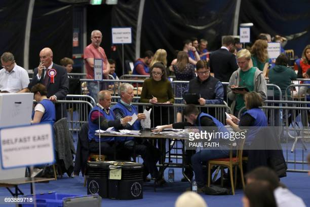The first Ballots are sorted at a counting centre in Titanic Exhibition in Belfast Northern Ireland on June 8 after the polls closed in Britain's...
