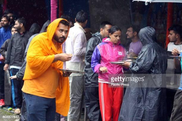 The first batch of Amarnath pilgrims reached Nunwan Pahalgam base camp amid security arrangements police said The Amarnath Yatra begins on Thursday A...