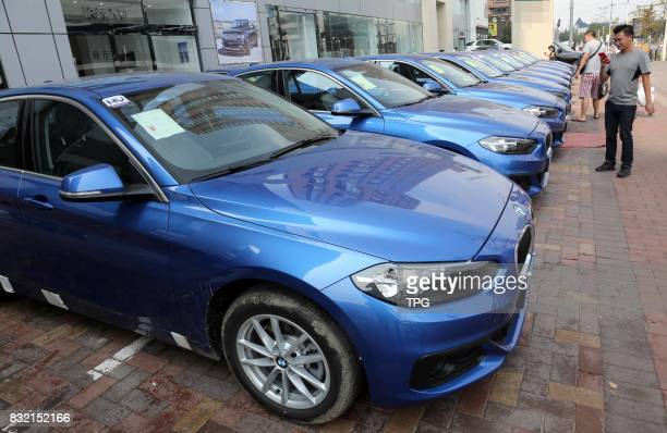 The first batch of BMWs soon available for car sharers are seen in the street of Shenyang City northeast Chinas Heilongjiang Province Aug 10 2017...