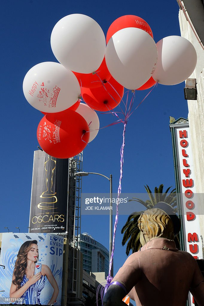 The first billboard announcing this year's upcoming Oscara, the 85th Academy Awards, is displayed outside the Dolby Theatre in Hollywood, California, on February 14, 2013. The ceremony is scheduled for February 24, 2013. AFP PHOTO / JOE KLAMAR