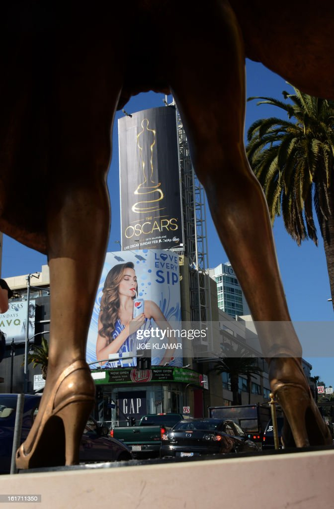 The first billboard announcing this year's upcoming OSCARS, the 85th Academy Awards, is displayed in front of the Dolby Theatre in Hollywood, California, on February 14, 2013. The ceremony is scheduled for February 24, 2013. AFP PHOTO / JOE KLAMAR