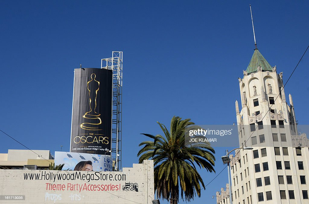 The first billboard (left) announcing this year's upcoming Oscars, the 85th Academy Awards, is displayed outside the Dolby Theatre in Hollywood, California, on February 14, 2013. The ceremony is scheduled for February 24, 2013. AFP PHOTO/JOE KLAMAR