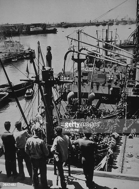 The first cargo of corn arriving at Genoa Italy sent from the United States as part of the Marshall Aid plan