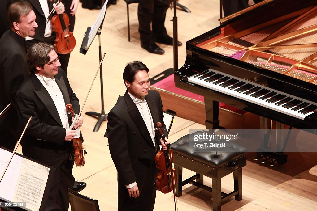 The first chair violinist stands before English pianist Stephen Hough arrives on stage to play the piano as Finnish conductor Osmo Vanska leads the London Philharmonic Orchestra in composer Antonin Dvorak's Piano Concerto in G minor in the Southbank Centre's the Royal Festival Hall on February 10, 2016 in London, England.
