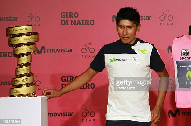 The first Colombian Giro d' Italia winner Nairo Quintana receives his trophy during the press conference at Movistar building Northern Bogota