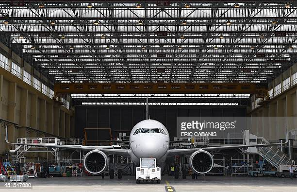 The first copy for test of the 200 mediumhaul Airbus A320neo passenger plane leaves its hangar on July 1 at the Airbus plant in SaintMartinduTouch...