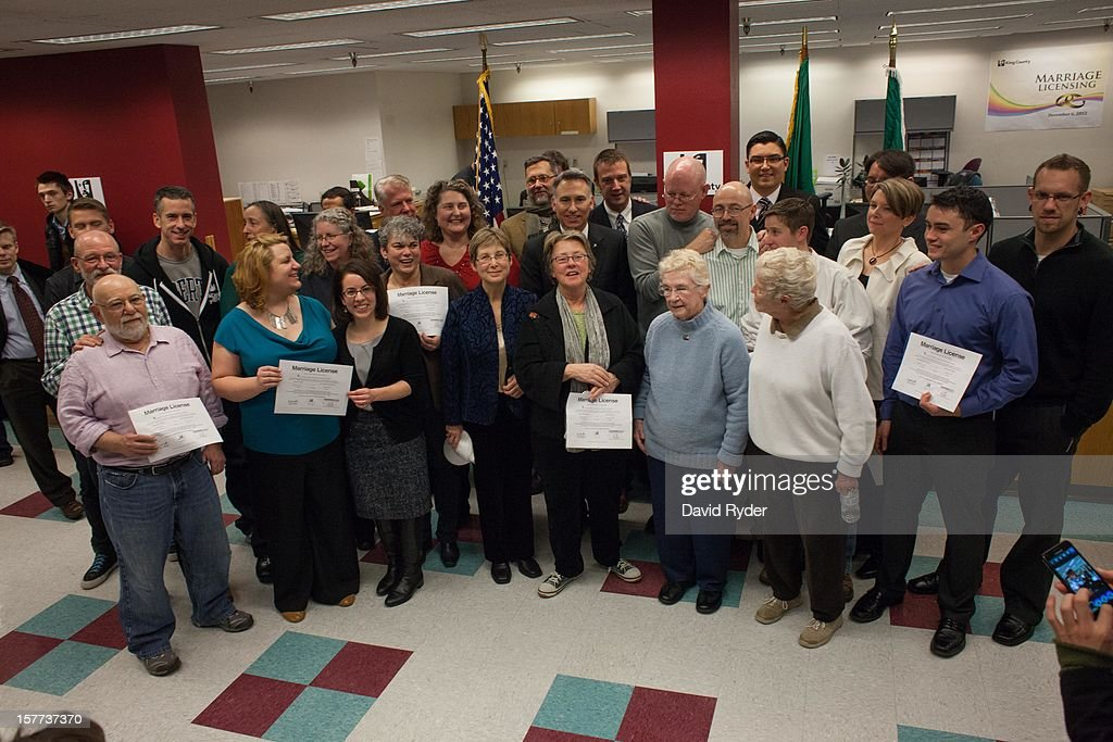 The first couples to receive marriage licenses in Washington state pose with King County Executive Dow Constantine, who signed their licenses, during a short ceremony at the King County Recorder's Office on December 6, 2012 in Seattle, Washington. The office opened at 12:01 AM PST to begin issuing marriage licenses to same-sex couples for the first time after Washington voters chose to legalize same-sex marriage in November's election.