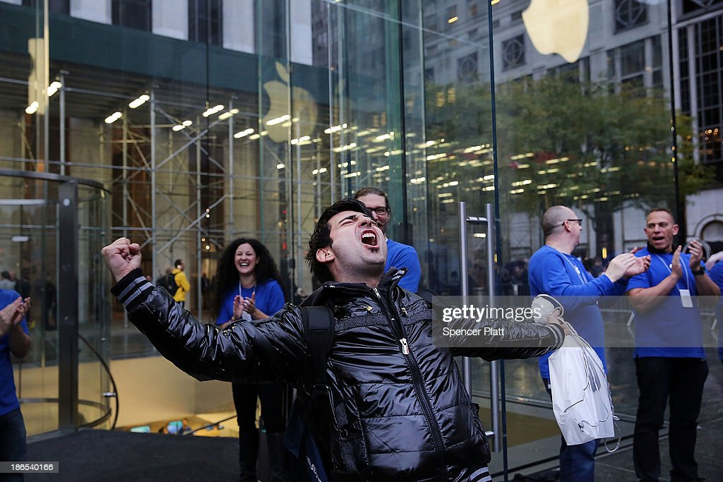 The first customer in line, Rami Shamis, celebrates his purchase of the new iPad Air at the Apple Store on November 1, 2013 in New York City. The new iPad, which will also come in a mini version, is 20% thinner and 28% lighter than the current fourth-generation iPad. It has the same 9.7-inch screen as previous iPads and uses the same A7 processing chip that's in the iPhone 5S. The iPad Air, which went on sale today, will start at $499 for a 16GB Wi-Fi-only model and go up to $629 for a 16GB with 4G LTE connectivity.