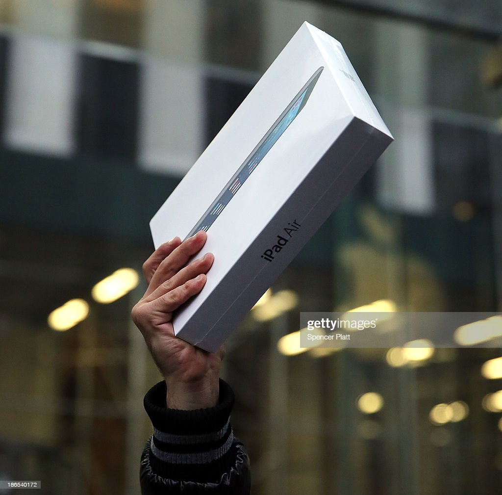 The first customer in line, Rami Shamis, holds up his new iPad Air at the Apple Store on November 1, 2013 in New York City. The new iPad, which will also come in a mini version, is 20% thinner and 28% lighter than the current fourth-generation iPad. It has the same 9.7-inch screen as previous iPads and uses the same A7 processing chip that's in the iPhone 5S. The iPad Air, which went on sale today, will start at $499 for a 16GB Wi-Fi-only model and go up to $629 for a 16GB with 4G LTE connectivity.