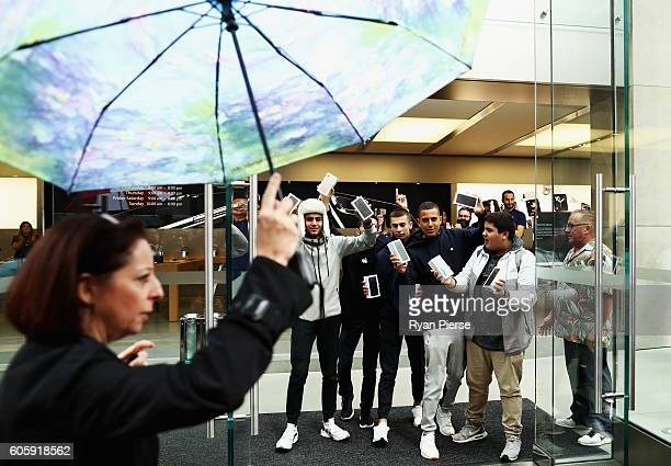 The first customers to buy the iPhone 7 pose at Apple Store on September 16 2016 in Sydney Australia Apple's latest iPhone features a waterproof body...