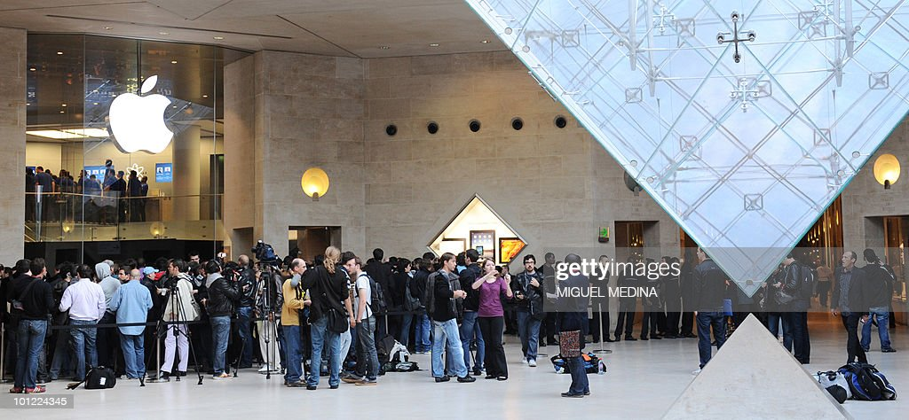The first customers wait for the opening of the Apple store at the Carrousel du Louvre in Paris as the iPad goes on sale on May 28, 2010. Apple's much-hyped iPad went on sale in a swathe of countries from Australia and Japan to Europe at the start of a global rollout tipped to change the face of computing. More than 5,000 applications have been developed for the iPad -- a flat, 10-inch (25-centimetre) black tablet targeted at the leisure market.