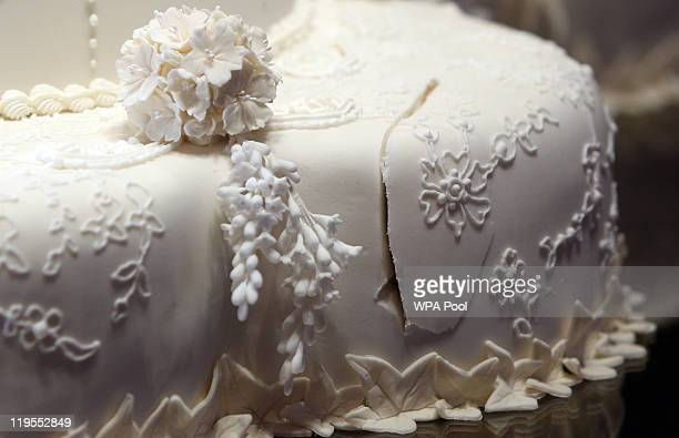 The first cut made by the Duke and Duchess of Cambridge in the royal wedding cake is photographed before it goes on display at Buckingham Palace...