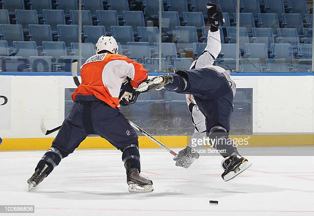 The first draft pick in 2010 for the New York Islanders Nino Niederreiter is hit Jason Diamond during rookie camp at Nassau Veterans Memorial...