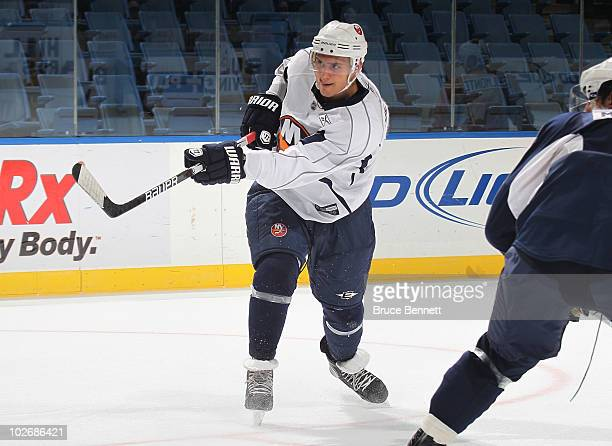 The first draft pick in 2010 for the New York Islanders Nino Niederreiter takes a shot during rookie camp at Nassau Veterans Memorial Coliseum on...