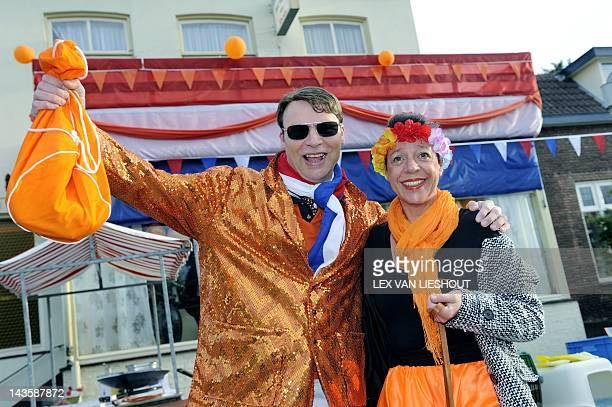 The first Dutch royal fans dressed in orange arrive in Rhenen The Netherlands on April 30 during the Queens Day celebration Queen's Day is a national...