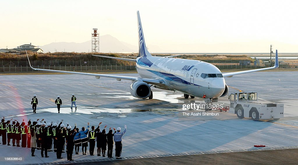 The first flight to Haneda airport taxis to the runway at Iwakuni-Kintaikyo Airport on December 13, 2012 in Iwakuni, Yamaguchi, Japan. The 98th airport in Japan, will share the runway with U.S. Army Iwakuni Base.