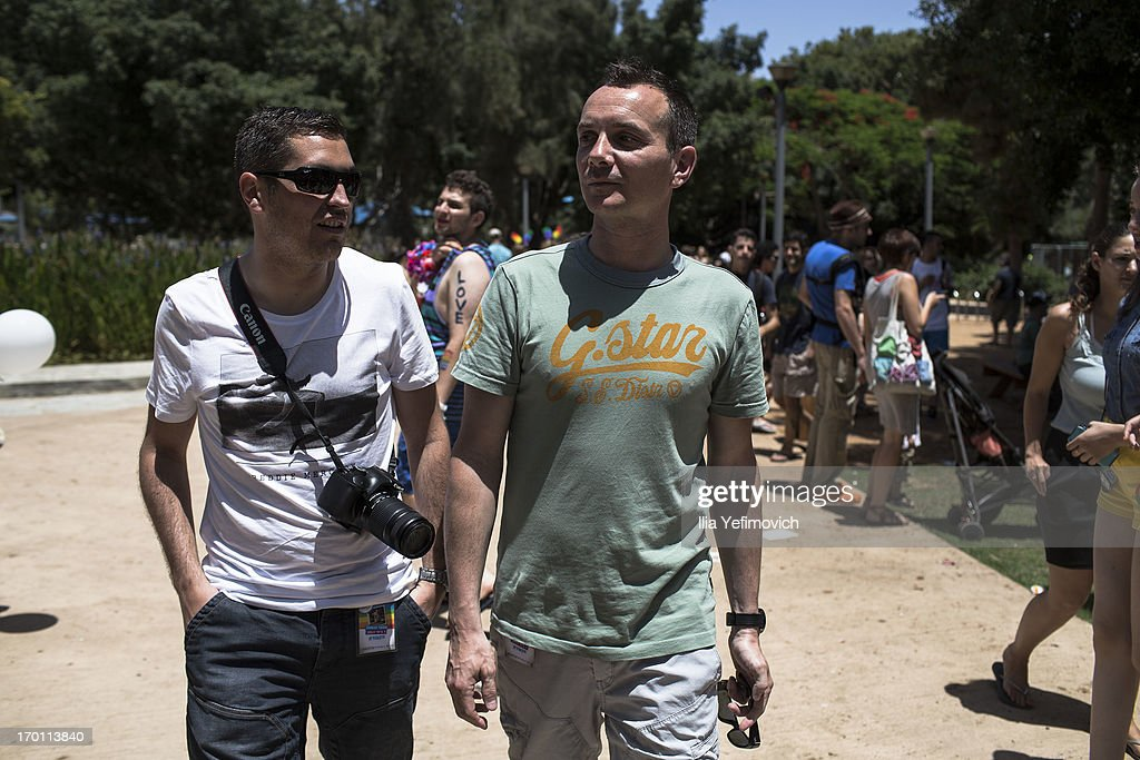 The first French married gay couple, <a gi-track='captionPersonalityLinkClicked' href=/galleries/search?phrase=Vincent+Autin&family=editorial&specificpeople=10121132 ng-click='$event.stopPropagation()'>Vincent Autin</a> (R) and his partner <a gi-track='captionPersonalityLinkClicked' href=/galleries/search?phrase=Bruno+Boileau&family=editorial&specificpeople=10957213 ng-click='$event.stopPropagation()'>Bruno Boileau</a> walk in the park during the annual Tel Aviv Gay Pride parade on June 7, 2013 in Tel Aviv, Israel. Thousands of people gathered in Tel Aviv for the parade, which attracts visitors from all over the world.