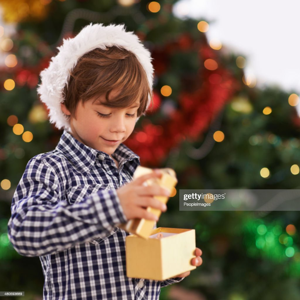 The first gift on Christmas morning : Stock Photo