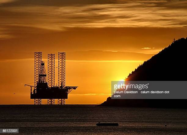 The first glimpse of day - Oil rig at sunrise