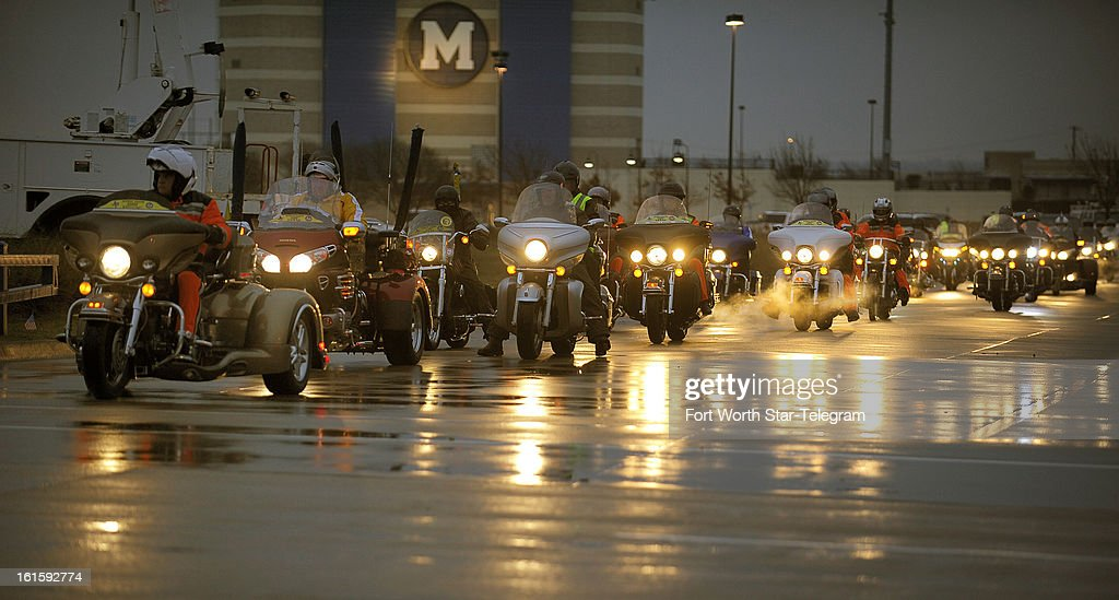 The first group of Patriot Guard Riders deploys before the funeral procession for Chris Kyle at Multi-Purpose Stadium, in Midlothian, Texas, Tuesday, February 12, 2013.