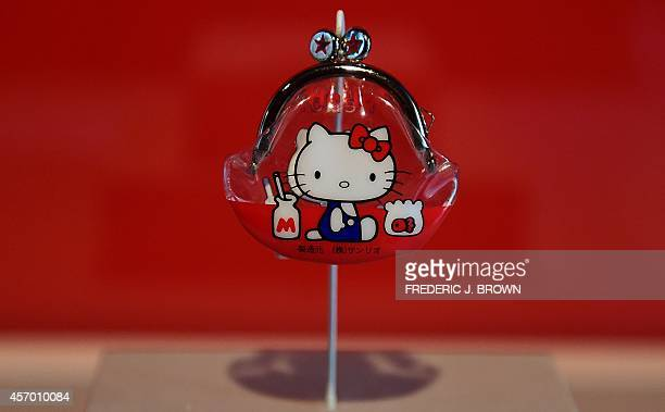 The first Hello Kitty item a small vinyl coin purse which debuted in March 1975 in Japan is displayed at a press event ahead of the opening of the...