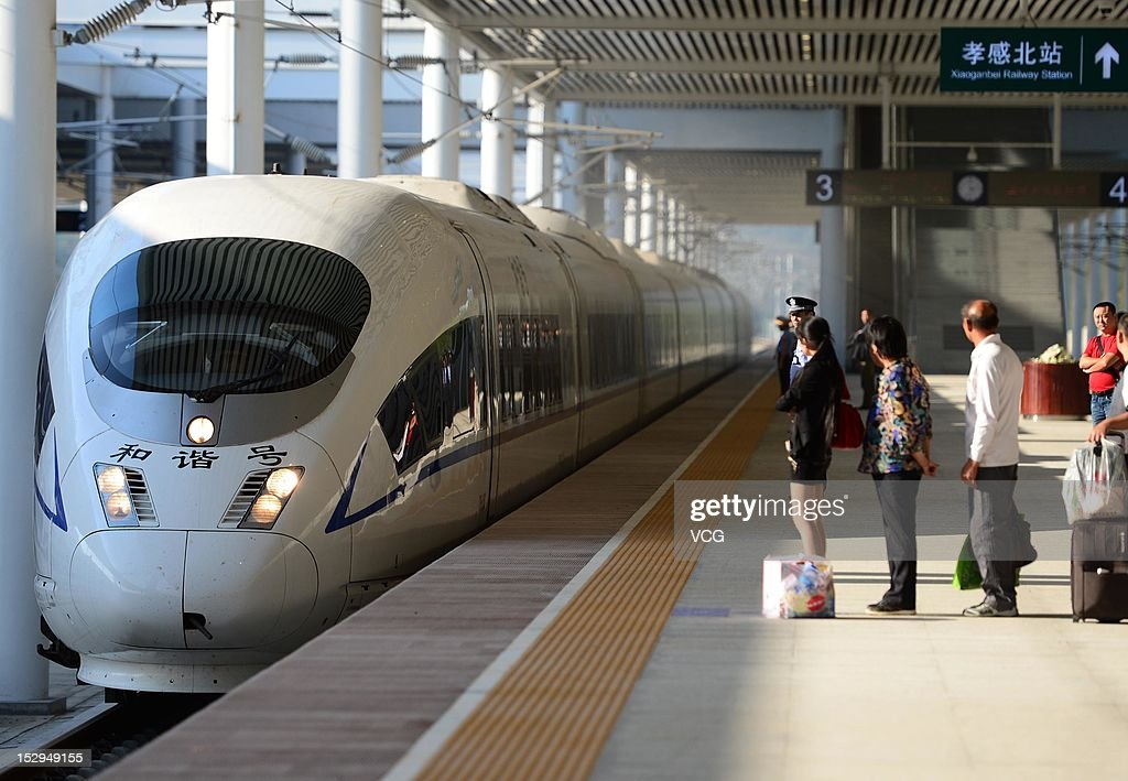 The first high-speed train between Zhengzhou and Wuhan runs into the Xiaoganbei Railday Station on September 28, 2012 in Xiaogan, Hubei Province of China. The high-speed train reduces the time between cities from four and a half hours to just two. It is a major part of the 2300km Bejing-Guangzhou high speed link which will be open by the year end.