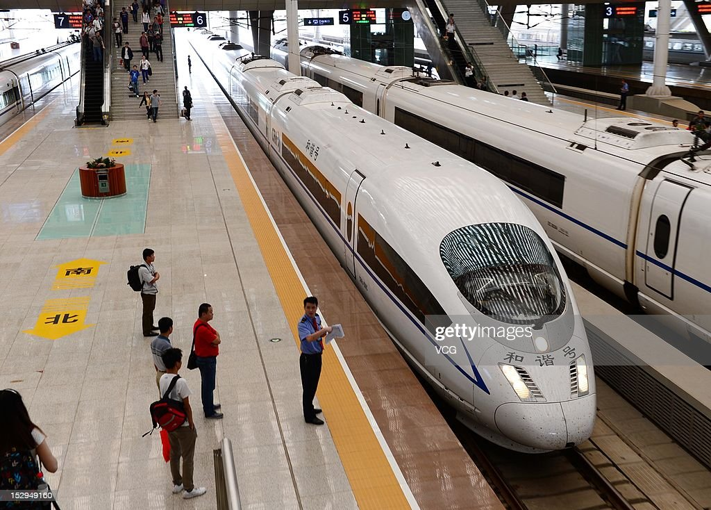 The first high-speed train between Zhengzhou and Wuhan runs into the Wuhan Railday Station on September 28, 2012 in Wuhan, Hubei Province of China. The high-speed train reduces the time between cities from four and a half hours to just two. It is a major part of the 2300km Bejing-Guangzhou high speed link which will be open by the year end.
