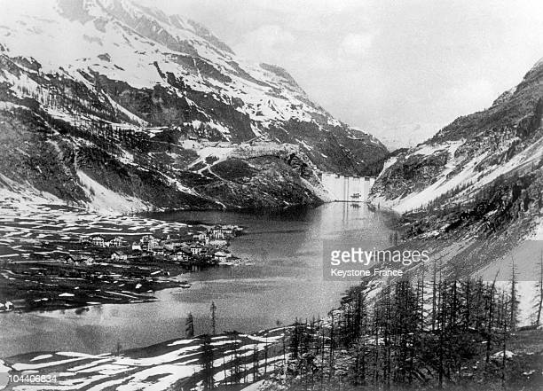 The first houses of Tignes become flooded by the dammed lake waters on April 22 1952