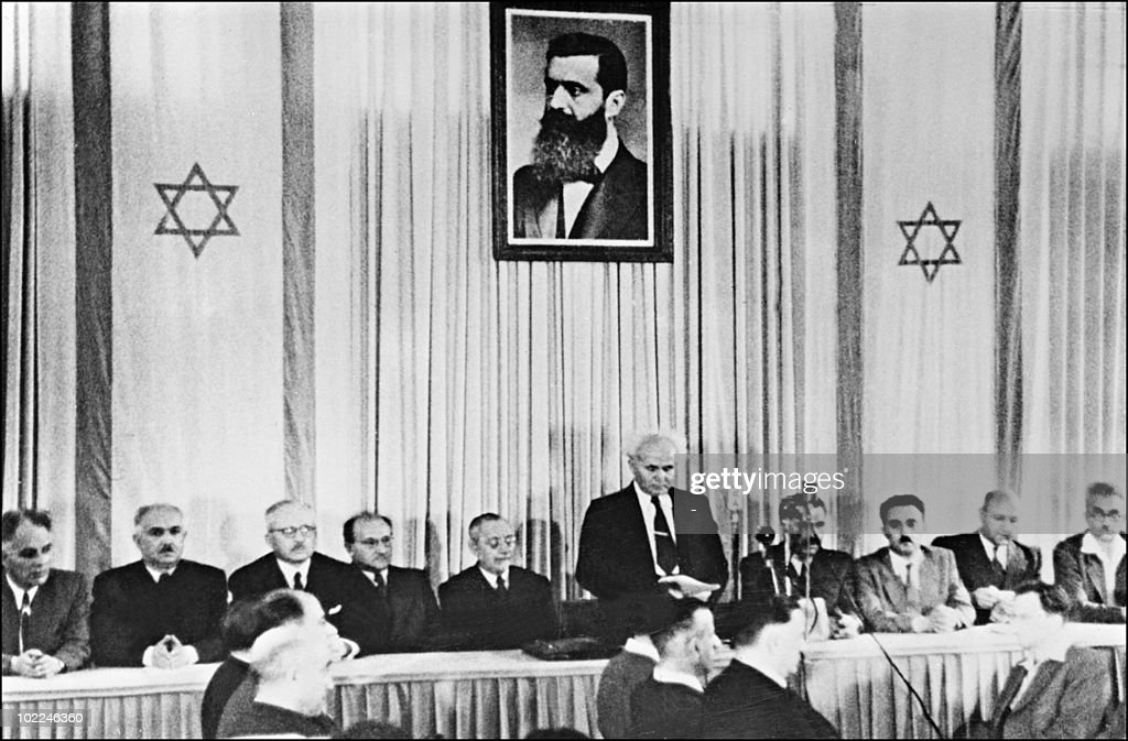 The first Israeli Prime minister David BenGurion surrounded by the members of the National Jewish Council at 601 pm 14 May 1948 in Tel Aviv...