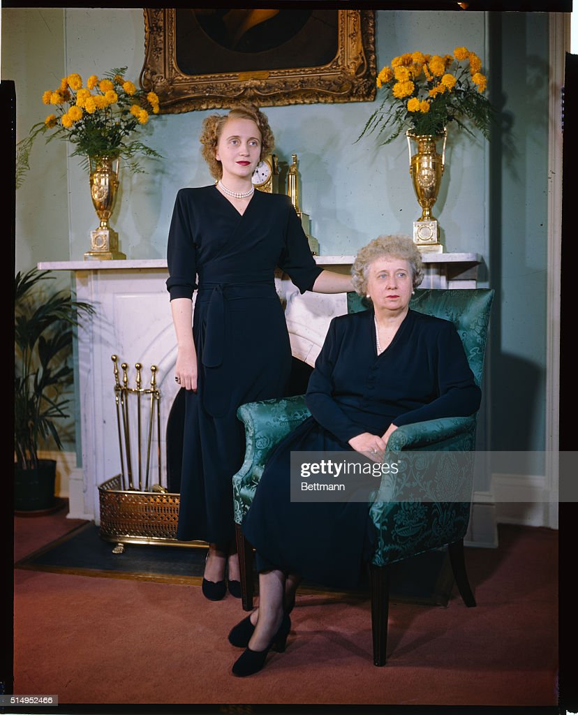 The first ladies of the land, Mrs. Harry S. Truman and her daughter, Margaret, pose for a new picture in front of the fireplace at the Blair House, their current home.