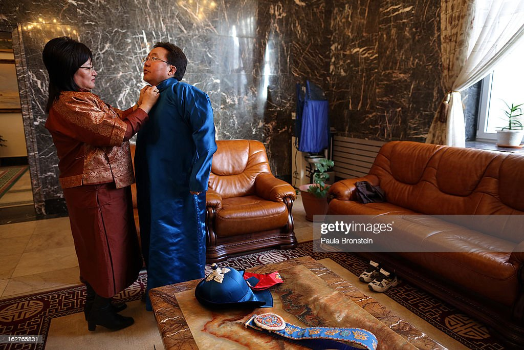 The First Lady, Bolormaa Khajidsuren assists her husband President <a gi-track='captionPersonalityLinkClicked' href=/galleries/search?phrase=Tsakhiagiin+Elbegdorj&family=editorial&specificpeople=5427078 ng-click='$event.stopPropagation()'>Tsakhiagiin Elbegdorj</a> as he gets ready to go horsebackriding on the estate on October 26, 2012 in Ulaanbataar, Mongolia. President <a gi-track='captionPersonalityLinkClicked' href=/galleries/search?phrase=Tsakhiagiin+Elbegdorj&family=editorial&specificpeople=5427078 ng-click='$event.stopPropagation()'>Tsakhiagiin Elbegdorj</a> was elected on May 25, 2009, having previously served two terms as Prime Minister and holding the positions of Deputy Speaker and Majority Leader in Parliament. The First Lady, Bolormaa Khajidsuren, is a mother of 4 children, and the extended Presidential family includes 20 foster children coming from a variety of government children's homes. Some 100 years ago, Mongolia gained independence from Qing China, and more than 20 years ago it removed itself from the Soviet Bloc. Since then, the country has been undergoing massive social, economic and political changes. The Oyu Tolgoi copper and gold mine is Mongolia's biggest foreign investment project to date adding an estimated 35% value to the country's GDP. Mongolia is the most sparsely populated country on earth with fewer than 3 million people.