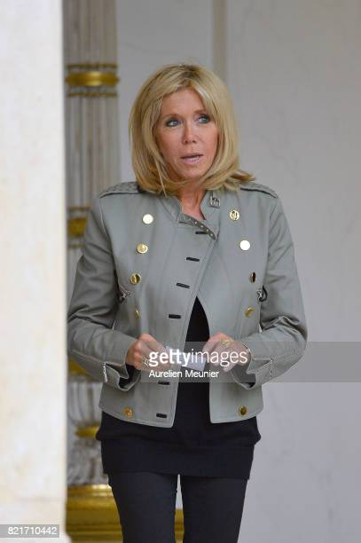 The First Lady Brigitte Macron escorts Bono out as he leaves the Elysee Palace after a meeting with French President Emmanuel Marcon on July 24 2017...