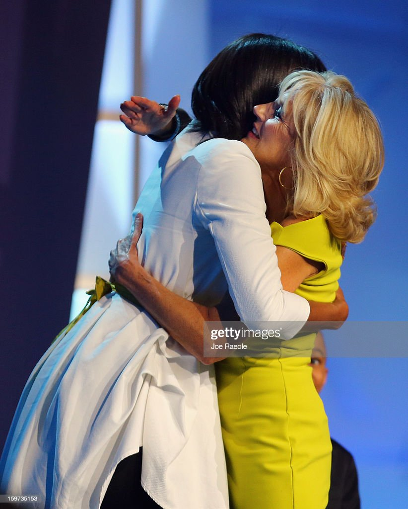 The First Lady Michelle Obama (L) is hugged by Jill Biden during the children's concert at the Washington Convention Center to celebrate military families on January 19, 2013 in Washington, DC. The U.S. capital is preparing for the second inauguration of U.S. President Barack Obama, which will take place on January 21.