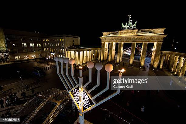 The first lamp of a large scale menorah in front of the Brandenburg Gate lights after it was lights by Rabbis Yehuda Teichtal and German Interior...