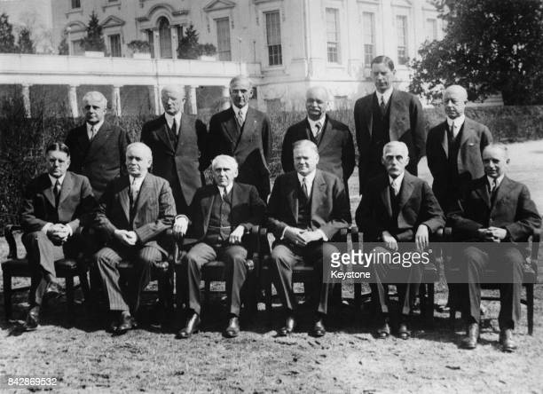 The first meeting of US President Herbert Hoover and his cabinet here photographed on the South Lawn of the White House Washington DC circa 1929 From...