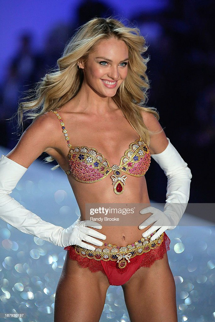 The first model out <a gi-track='captionPersonalityLinkClicked' href=/galleries/search?phrase=Candice+Swanepoel&family=editorial&specificpeople=4357958 ng-click='$event.stopPropagation()'>Candice Swanepoel</a> walks in the 2013 Victoria's Secret Fashion Show at Lexington Avenue Armory on November 13, 2013 in New York City.