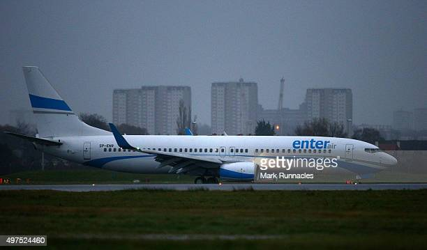The first of a series of charter flights carrying refugees arrives at Glasgow Airport on November 17 2015 in Glasgow Scotland The refugees are from...