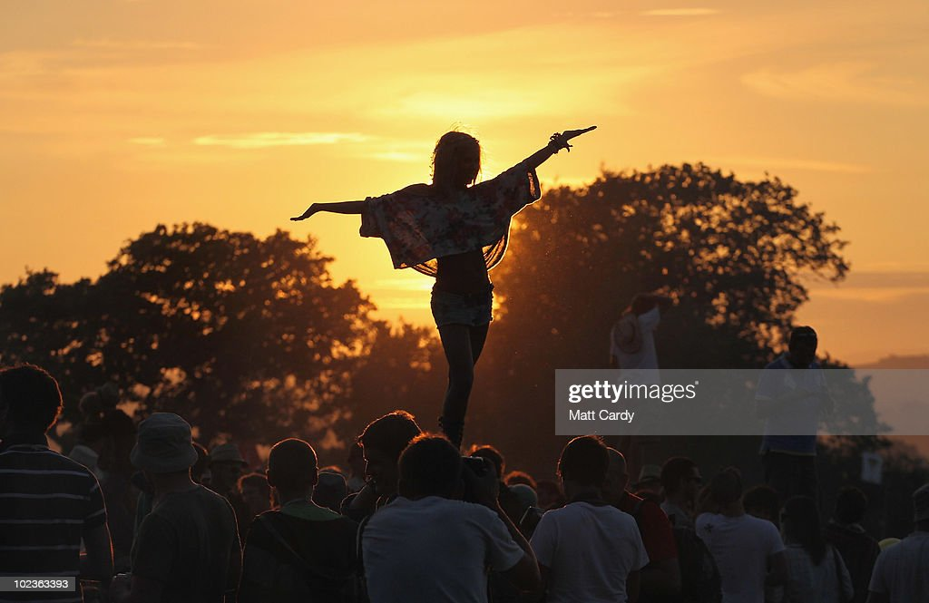 The first of the 140,000 music fans due at this year's Glastonbury Festival enjoy the sunset at Worthy Farm, Pilton on June 23, 2010 in Glastonbury, England. The gates opened this morning at 8am to what has become Europe's largest music festival and is celebrating its 40th anniversary.